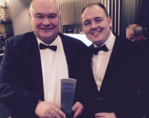 John Morrey, winner of Outstanding Contribution by an Individual, with Captive Review editor Richard Cutcher.